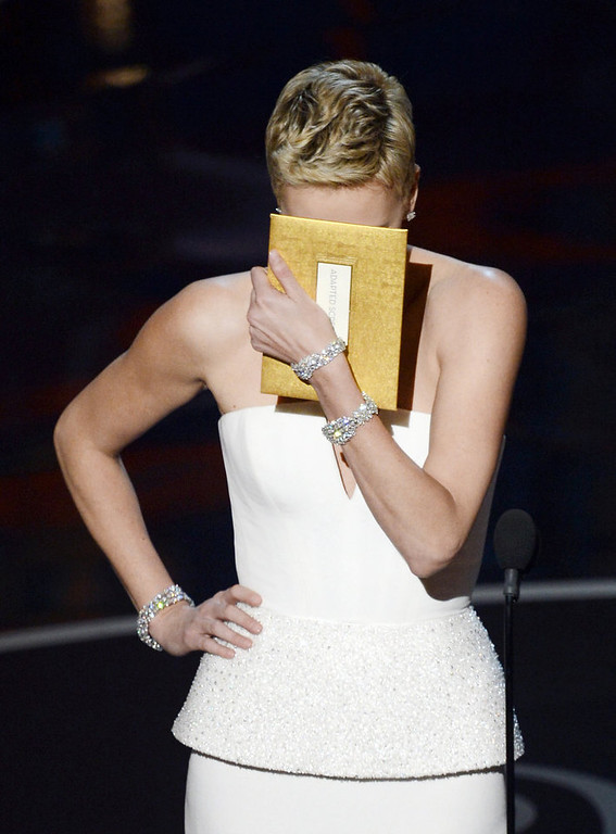 . Actress Charlize Theron reacts as she presents onstage during the Oscars held at the Dolby Theatre on February 24, 2013 in Hollywood, California.  (Photo by Kevin Winter/Getty Images)