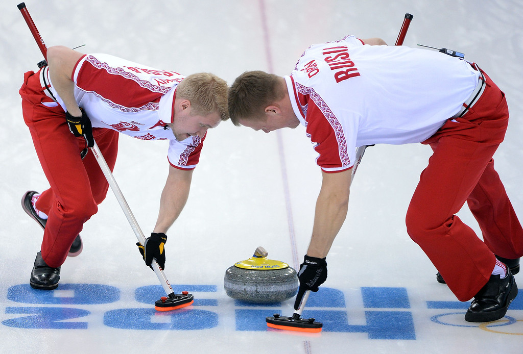 . Russia\'s Alexey Stukalskiy (L) and Petr Dron sweep the ice during the Men\'s Curling Round Robin Session 10 against Sweden at the Ice Cube Curling Center during the Sochi Winter Olympics on February 16, 2014.  AFP PHOTO / ANDREJ ISAKOVICANDREJ ISAKOVIC/AFP/Getty Images