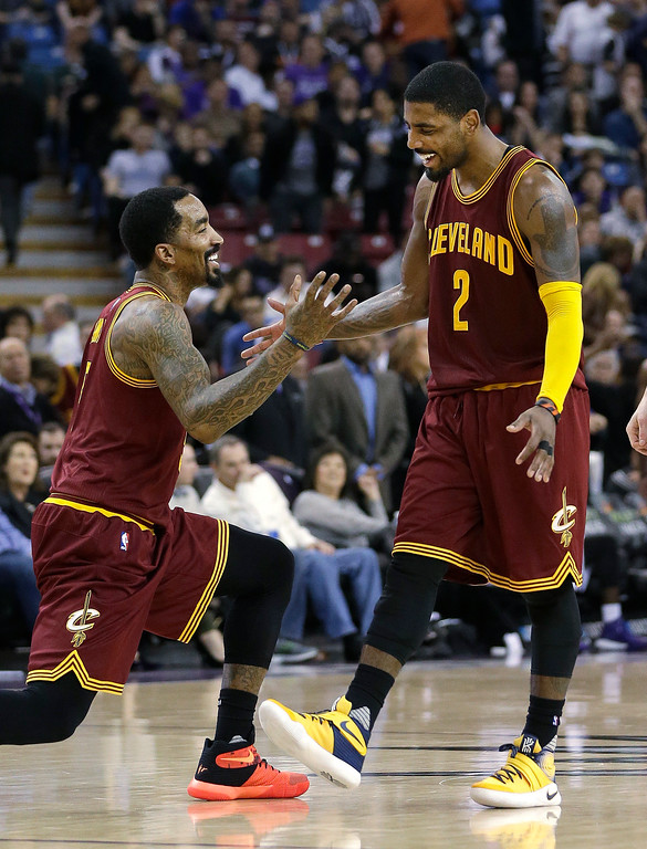 . Cleveland Cavaliers\' J.R. Smith, left, and Kyrie Irving celebrate during the final moments of the Cavaliers\' 120-111 win over the Sacramento Kings in an NBA basketball game Wednesday, March 9, 2016, in Sacramento, Calif. (AP Photo/Rich Pedroncelli)