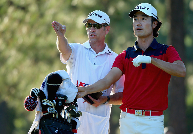 . Kevin Na of the United States talks with caddie Kenny Harms on the 17th hole during the third round of the 114th U.S. Open at Pinehurst Resort & Country Club, Course No. 2 on June 14, 2014 in Pinehurst, North Carolina.  (Photo by Andrew Redington/Getty Images)