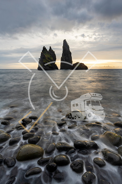 Sunrise landscape at rock structures in the sea at Baía de Alagoa on the fairy tale island of Ilha das Flores, Azores