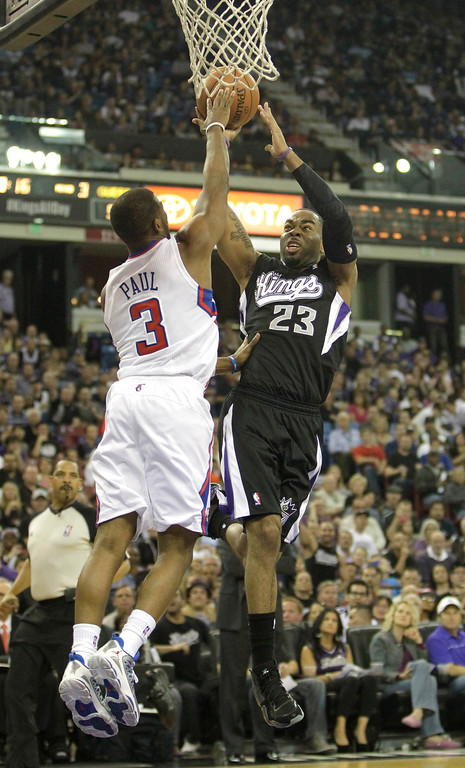 . Sacramento Kings guard Marcus Thornton, right, shoots over Los Angeles Clippers guard Chris Paul in the third quarter of  an NBA basketball game in Sacramento, Calif., Wednesday,  April 17, 2013.  The Clippers own 112-108.(AP Photo/Rich Pedroncelli)