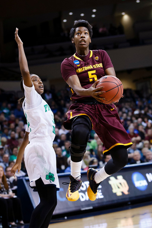 . Arizona State guard Deja Mann (5) goes to the basket on Notre Dame guard Jewell Loyd (32) in the first half in a second-round game in the NCAA women\'s college basketball tournament in Toledo, Ohio, Monday, March 24, 2014. (AP Photo/Rick Osentoski)