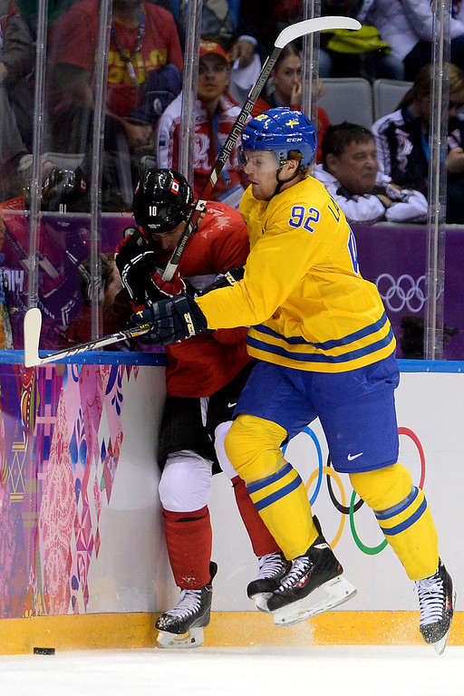 . Gabriel Landeskog (92) of Sweden checks Patrick Sharp (10) of Canada during the first period of the men\'s ice hockey gold medal game. Sochi 2014 Winter Olympics on Sunday, February 23, 2014 at Bolshoy Ice Arena. (Photo by AAron Ontiveroz/ The Denver Post)