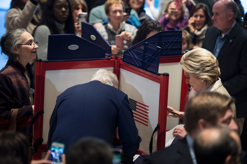 . Former US President Bill Clinton (L) and Democratic presidential nominee Hillary Clinton (R)vote at Douglas G. Griffin School November 8, 2016 in Chappaqua, New York. / AFP / Brendan Smialowski        (Photo credit should read BRENDAN SMIALOWSKI/AFP/Getty Images)