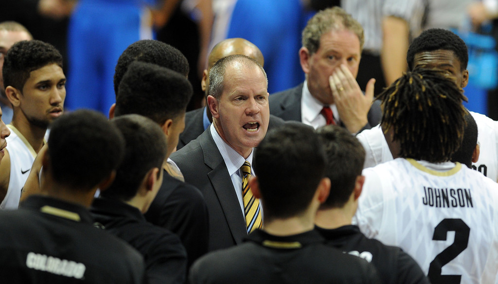. CU coach Tad Boyle talks to the team during the second half of the January 16, 2014 game in Boulder.  (Cliff Grassmick/Daily Camera)