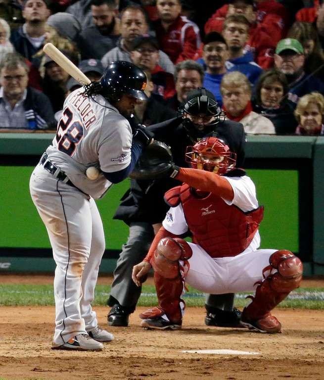 . Detroit Tigers first baseman Prince Fielder gets hit by a pitch from Boston Red Sox starting pitcher Jon Lester in front of Red Sox catcher David Ross, right, in sixth inning during Game 1 of the American League baseball championship series Saturday, Oct. 12, 2013, in Boston. (AP Photo/Charlie Riedel)