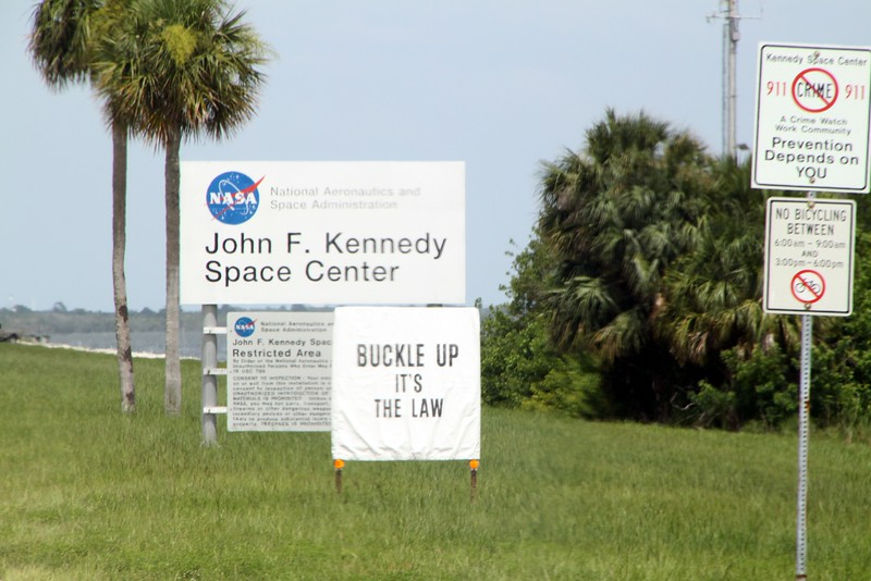 Signs at the entrance to the John F. Kennedy Space Center