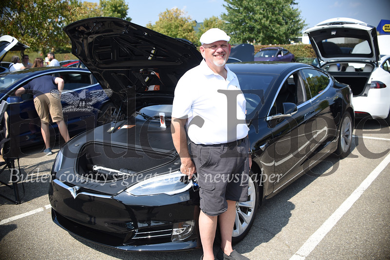 Jim Butchko of Economy Borough in Beaver County Tesla Model S at an electric car show in Cranberry Township Saturday afternoon. Tanner Cole/Butler Eagle
