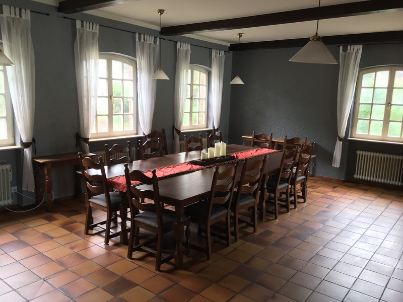 Large table is furnished with the house.