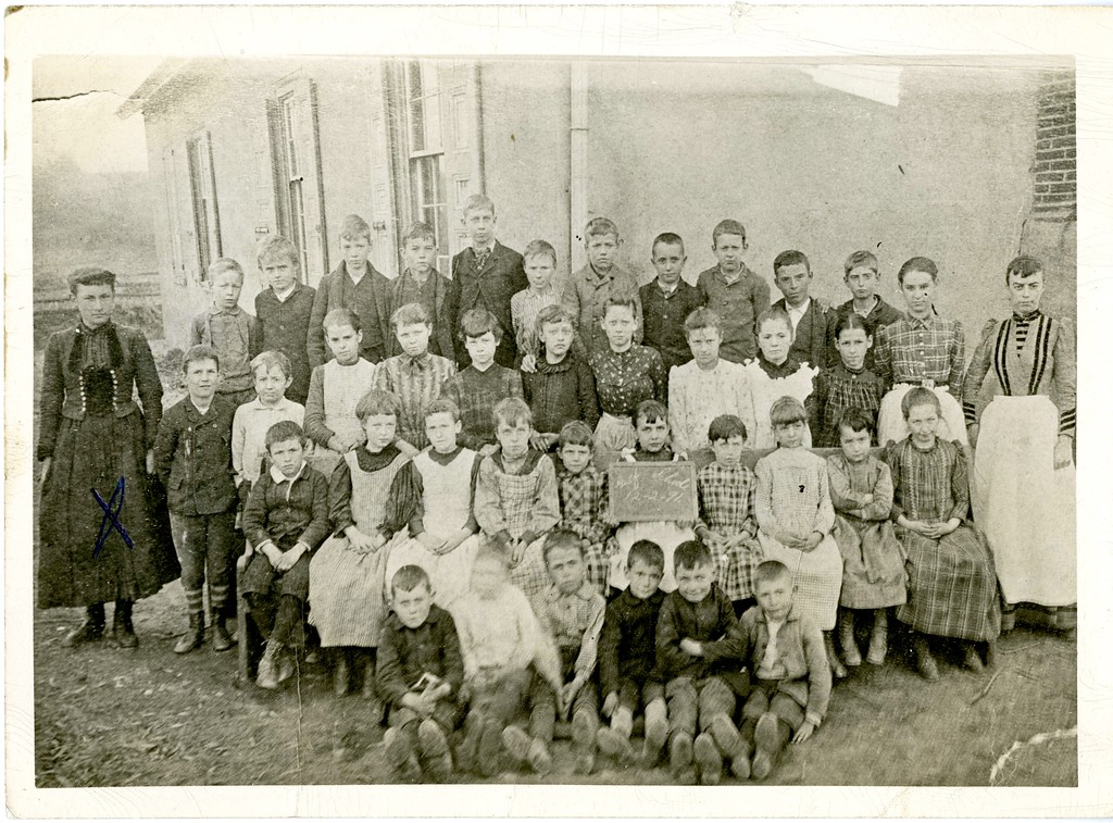. This photo from the Historical Society of Montgomery County is a class picture from the Gulf School in 1891. The teacher on the right is Ann Davis.