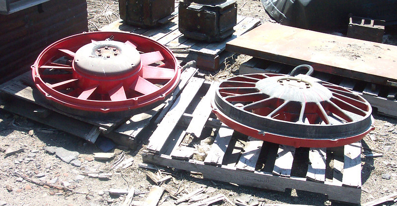 36-inch radiator fans. The one on the right is laying upside down. At Grand Island, Nebr. on the Nebreaka Central. July 2002. <i>Don Strack Photo</i>