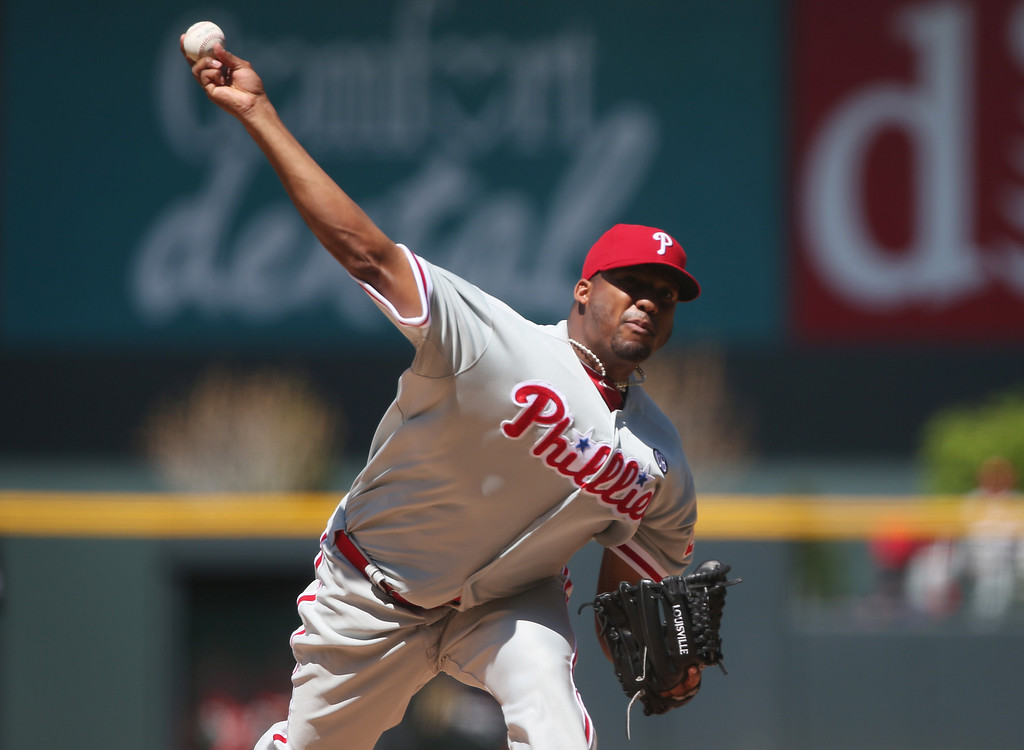 . Philadelphia Phillies starting pitcher Roberto Hernandez works against the Colorado Rockies in the first inning of a baseball game in Denver, Sunday, April 20, 2014. (AP Photo/David Zalubowski)