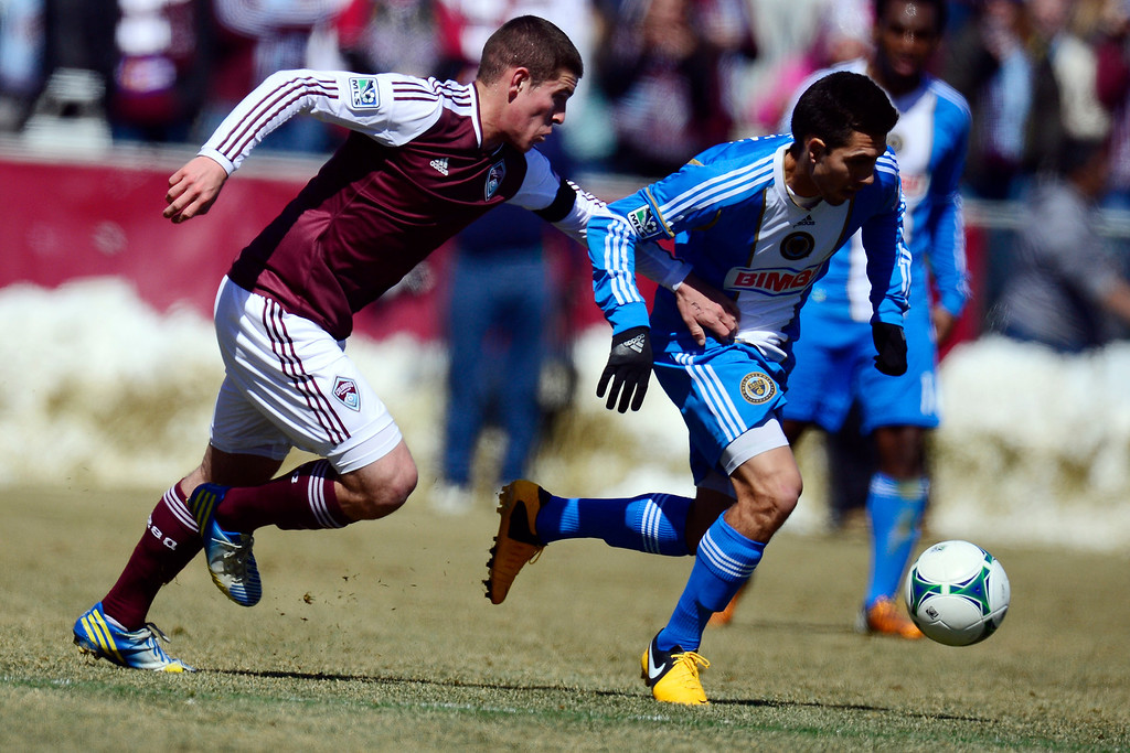 . COMMERCE CITY, CO - MARCH 10: Dillon Powers (8) of the Colorado Rapids defends Michael Farfan (21) of the Philadelphia Union during the first half of action. The Colorado Rapids play the Philadelphia Union at Dick\'s Sporting Goods Park. (Photo By AAron Ontiveroz/The Denver Post)