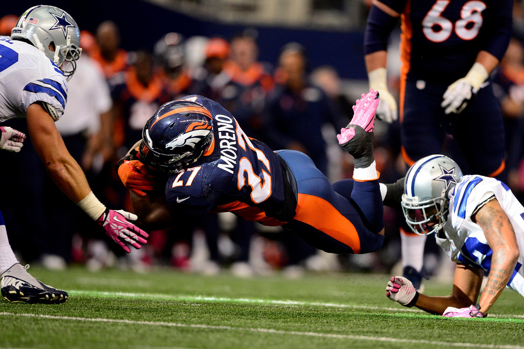 . ARLINGTON, TX - OCTOBER 6: Knowshon Moreno (27) of the Denver Broncos dives for yards against the Dallas Cowboys during the first half of action at AT&T Stadium. The Denver Broncos visit the Dallas Cowboys. (Photo by AAron Ontiveroz/The Denver Post)