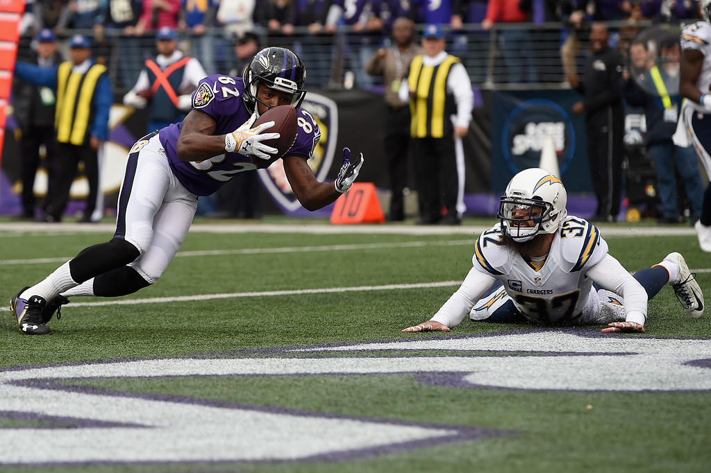 . BALTIMORE, MD - NOVEMBER 30:  Wide receiver Torrey Smith #82 of the Baltimore Ravens catches a touchdown over free safety Eric Weddle #32 of the San Diego Chargers in the first quarter of a game at M&T Bank Stadium on November 30, 2014 in Baltimore, Maryland.  (Photo by Patrick Smith/Getty Images) *** BESTPIX ***