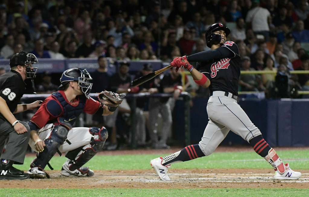 . CORRECTS RIVAL TEAM TO MINNESOTA TWINS -  Cleveland Indians\' infielder Francisco Lindor hits a home run against the Minnesota Twins during the fifth inning of game one of a two-game MLB Series at Hiram Bithorn Stadium in San Juan, Puerto Rico, Tuesday, April 17, 2018. (AP Photo/Carlos Giusti)