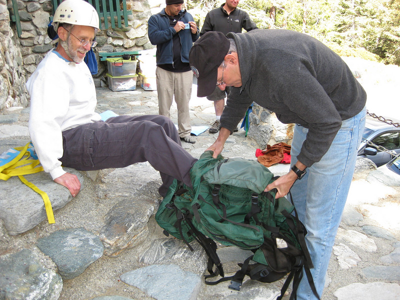 Steve and George making backpack carrier