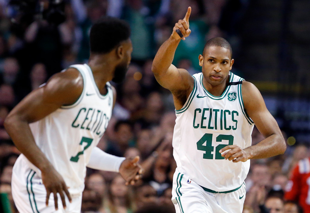 . Boston Celtics forward Al Horford (42) celebrates a made basket with guard Jaylen Brown (7) during the first quarter of Game 1 of the NBA basketball Eastern Conference Finals against the Cleveland Cavaliers, Sunday, May 13, 2018, in Boston. (AP Photo/Michael Dwyer)