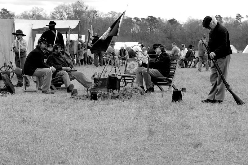 Reenactors from several companies relax across the field during lunch. The Skirmish at Gamble's Hotel happened on March 5, 1885 when 500 federal soldiers, under the command of Reuben Williams of the 12th Indiana Infantry, marched into Florence to destroy the railroad depot but were met by Confederate soldiers backed up with 400 militia. The reenactment, held by the 23rd South Carolina Infantry, was held at the Rankin Plantation in Florence, South Carolina on Saturday, March 5, 2011. Photo Copyright 2011 Jason Barnette