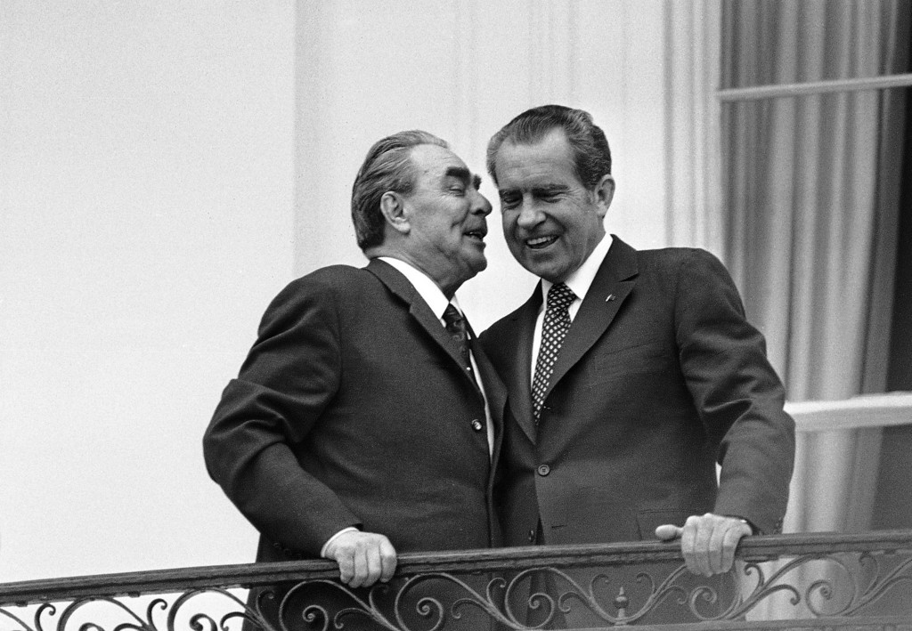 . In this June 18,1973 file photo, Soviet leader Leonid I. Brezhnev, left, whispers in the ear of President Richard M. Nixon as the two leaders stand on a balcony at the White House in Washington. The meeting was the only summit ever recorded on an American presidential taping system. The last 340 hours of tapes from Nixon\'s White House were released Wednesday, Aug. 21, 2013, along with more than 140,000 pages of text materials. (AP Photo/File)