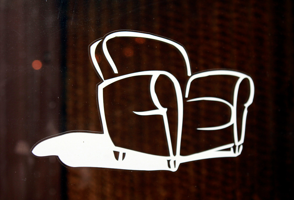 . Ted Boerner and Frank Pontes founded Ted Boerner, Inc., 20 years ago and one of their earlier logo designs of a chair still graces their front door Wednesday, July 10, 2013 at their offices in San Francisco, Calif. (Karl Mondon/Bay Area News Group)