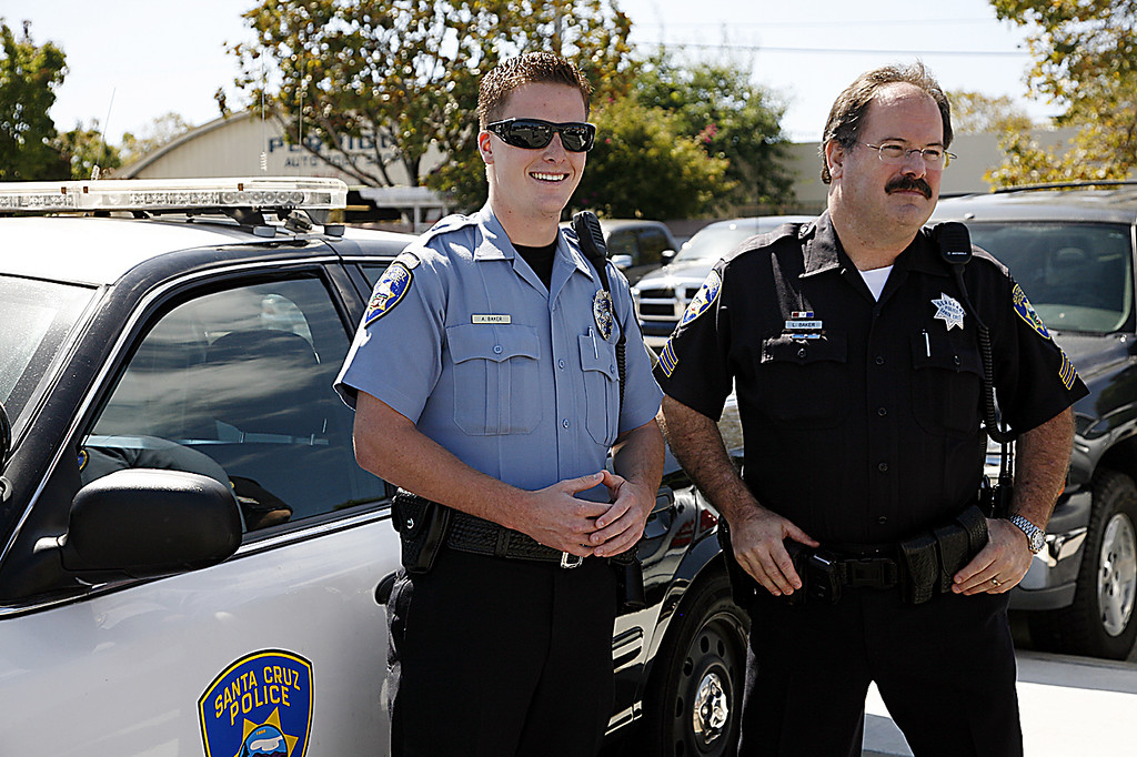 """. <a href=\""""http://www.santacruzsentinel.com/localnews/ci_22676928\"""">Loran \'Butch\' Baker</a> with his son, Adam, when Adam joined the SCPD as a Community Service Officer in September, 2010.  (Larissa Mueller/Sentinel)"""