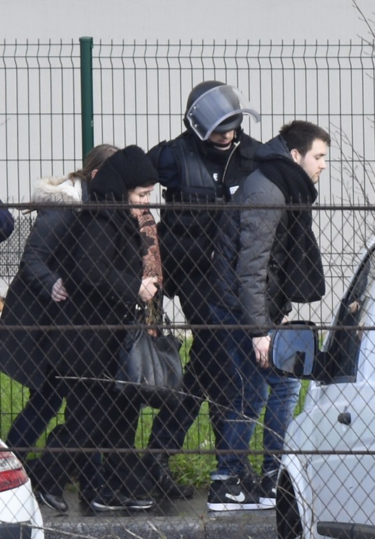. French police special forces evacuate local residents on January 9, 2015 in Saint-Mande, near Porte de Vincennes, eastern Paris, after at least one person was injured when a gunman opened fire at a kosher grocery store on January 9, 2015 and took at least five people hostage, sources told AFP. The attacker was suspected of being the same gunman who killed a policewoman in a shooting in Montrouge in southern Paris on January 8. AFP PHOTO / MARTIN BUREAU/AFP/Getty Images