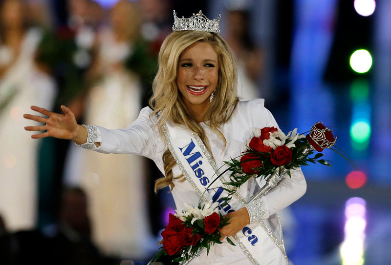 . Miss New York Kira Kazantsev, right, walks the runway after she was named Miss America 2015 during the Miss America 2015 pageant, Sunday, Sept. 14, 2014, in Atlantic City, N.J. (AP Photo/Mel Evans)