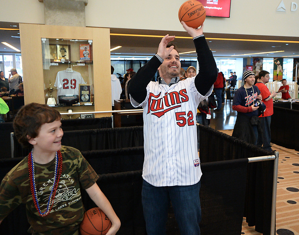 . Colton Strain, eleven years-old, plays a game of PIG with Twins pitcher Brian Duensing while at Twinsfest at Target Field, Saturday, January 25, 2014. Colton won. (Pioneer Press: John Autey)