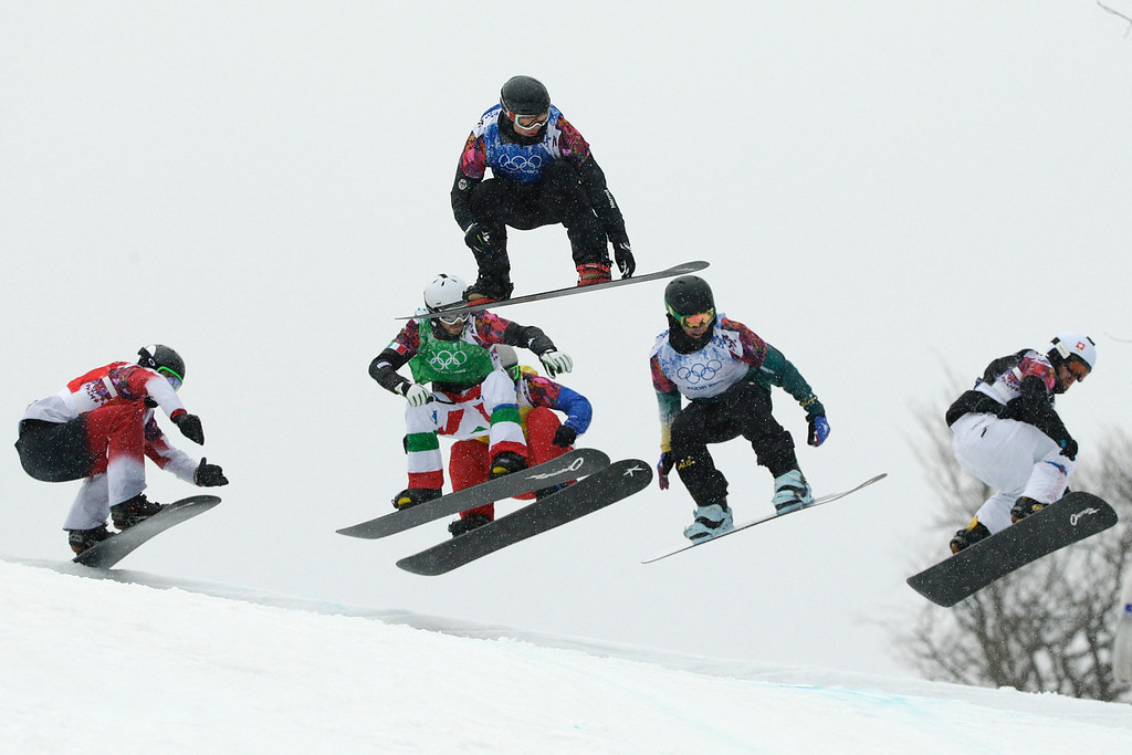 . Canada\'s Christopher Robanske, from left, Italy\'s Luca Matteotti, France\'s Paul-Henri de Le Rue, Germany\'s Paul Berg, Australia\'s Cameron Bolton, and Switzerland\'s Tim Watter compete during the men\'s snowboard cross quarterfinal at the Rosa Khutor Extreme Park, at the 2014 Winter Olympics, Tuesday, Feb. 18, 2014, in Krasnaya Polyana, Russia. (AP Photo/Jae C. Hong)