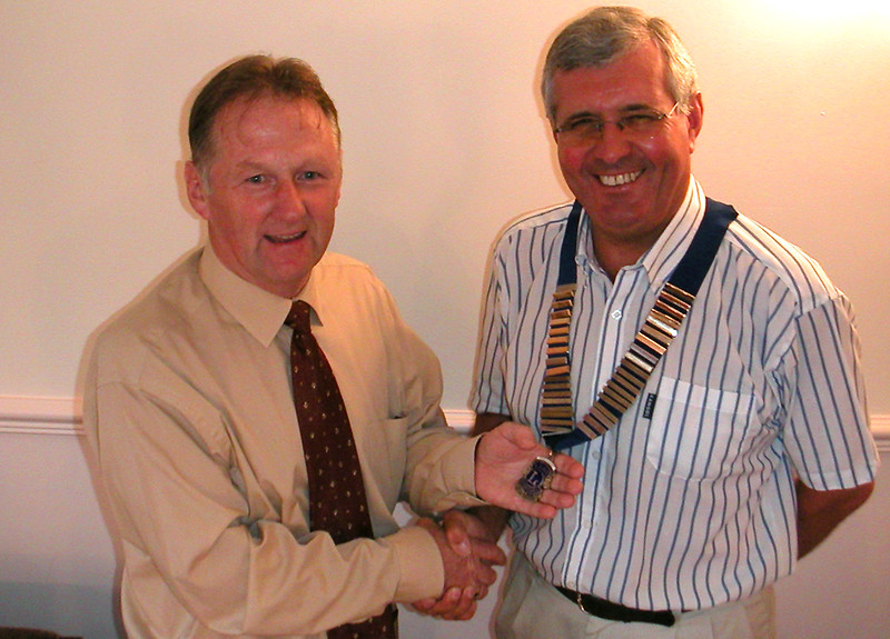 Retiring president of the Isle of Axholme Lions, Terry Condliff hands over the chain of office to president for the next year Alan Holgate, at a dinner held in the School Inn, Epworth