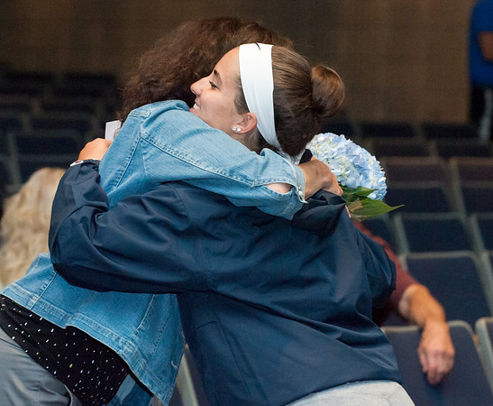 06/12/18 Wesley Bunnell | Staff Dawn Ferrante hugs her daughter Gabby and presented her with flowers after signing her commitment to play college softball. Southington High School held college signings on Tuesday afternoon for 14 student athletes committed to playing college sports.