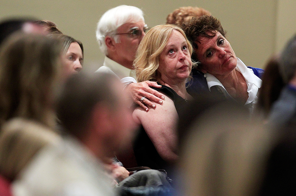 . Mourners console one another during Mindy McCready\'s funeral ceremony at the Crossroads Baptist Church in Fort Myers, Fla., on Tuesday, Feb. 26, 2013.  McCready committed suicide Feb. 17 at her home in Arkansas, days after leaving a court-ordered substance abuse program. (AP Photo/Naples Daily News, Corey Perrine)