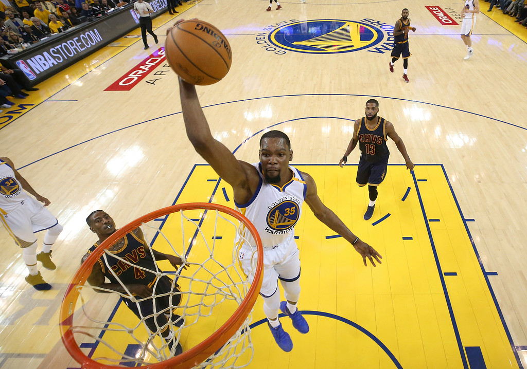 . Golden State Warriors forward Kevin Durant (35) dunks against the Cleveland Cavaliers during the first half of Game 1 of basketball\'s NBA Finals in Oakland, Calif., Thursday, June 1, 2017. (Ezra Shaw/Pool Photo via AP)