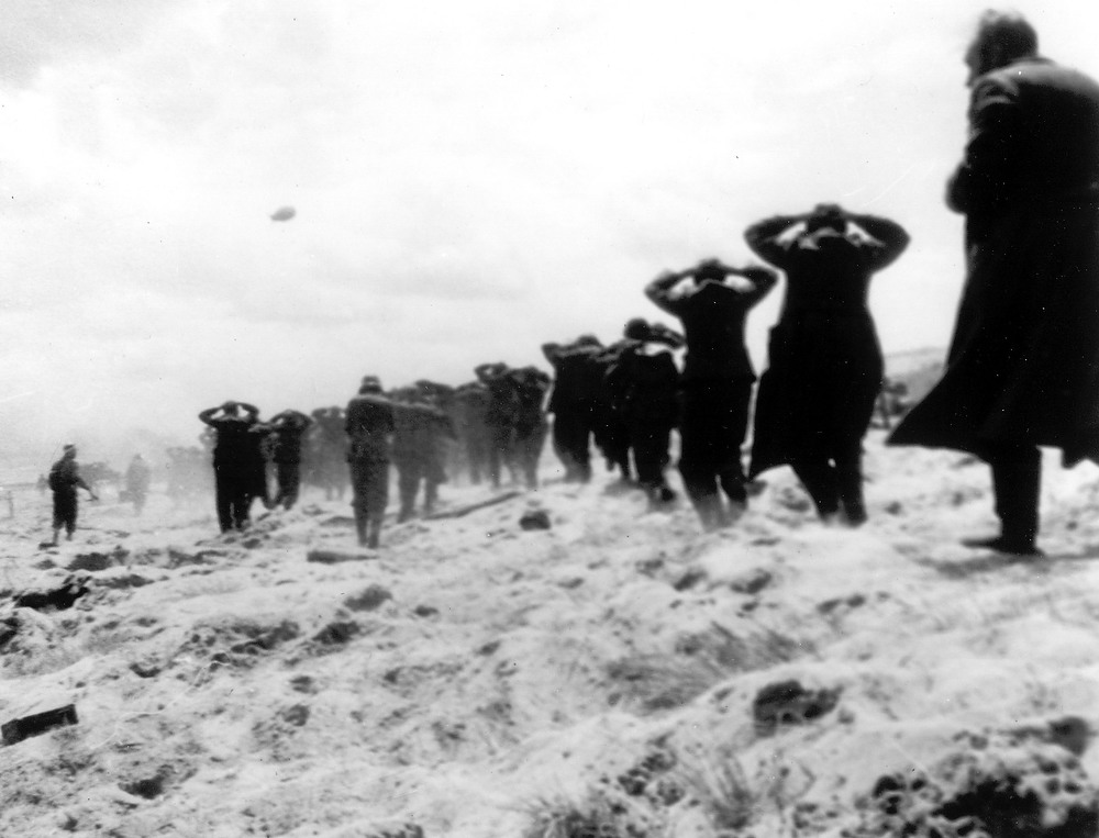 Description of . German prisoners of war are led away by Allied forces from Utah Beach, on June 6, 1944, during landing operations at the Normandy coast, France. (AP Photo)