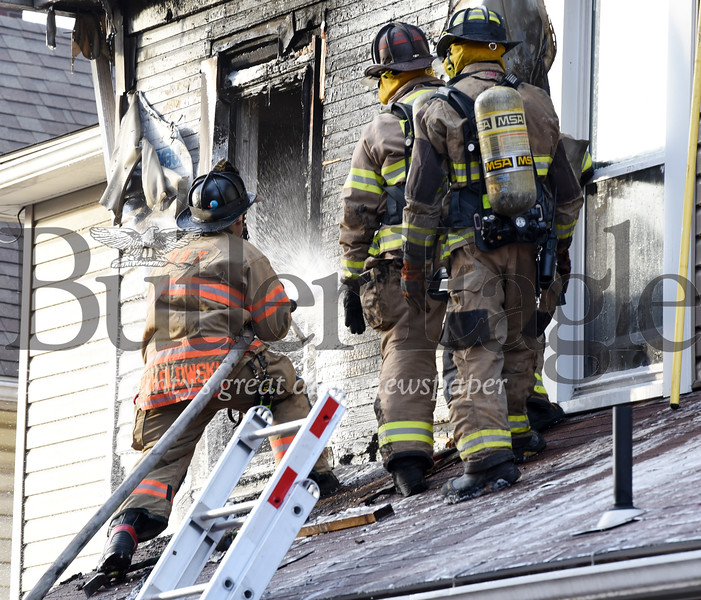 Harold Aughton/Butler Eagle: Butler firefighters battled a blaze that broke out at 221 W. North Street in Butler Thursday, December 26, 2019.