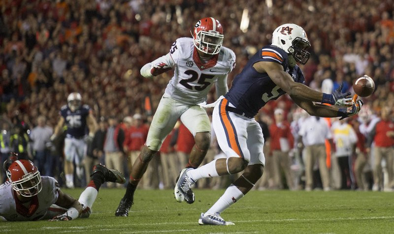 ". <p>9. GEORGIA BULLDOGS <p>On the bright side, their defensive backs credited with assist on Auburn�s �Hail Mary� winner. (unranked) <p><b><a href=\'http://www.usatoday.com/story/sports/ncaaf/sec/2013/11/16/college-football-auburn-tigers-georgia-bulldogs/3614089/\' target=""_blank\""> HUH?</a></b> <p>    (AP Photo/Opelika-Auburn News, Albert Cesare)"