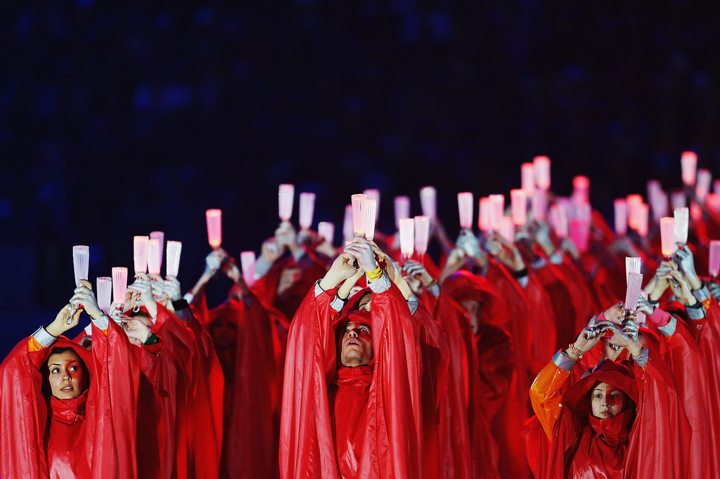 . Performers hold glow sticks during the Sochi 2014 Paralympic Winter Games Closing Ceremony at Fisht Olympic Stadium on March 16, 2014 in Sochi, Russia.  (Photo by Dennis Grombkowski/Getty Images)