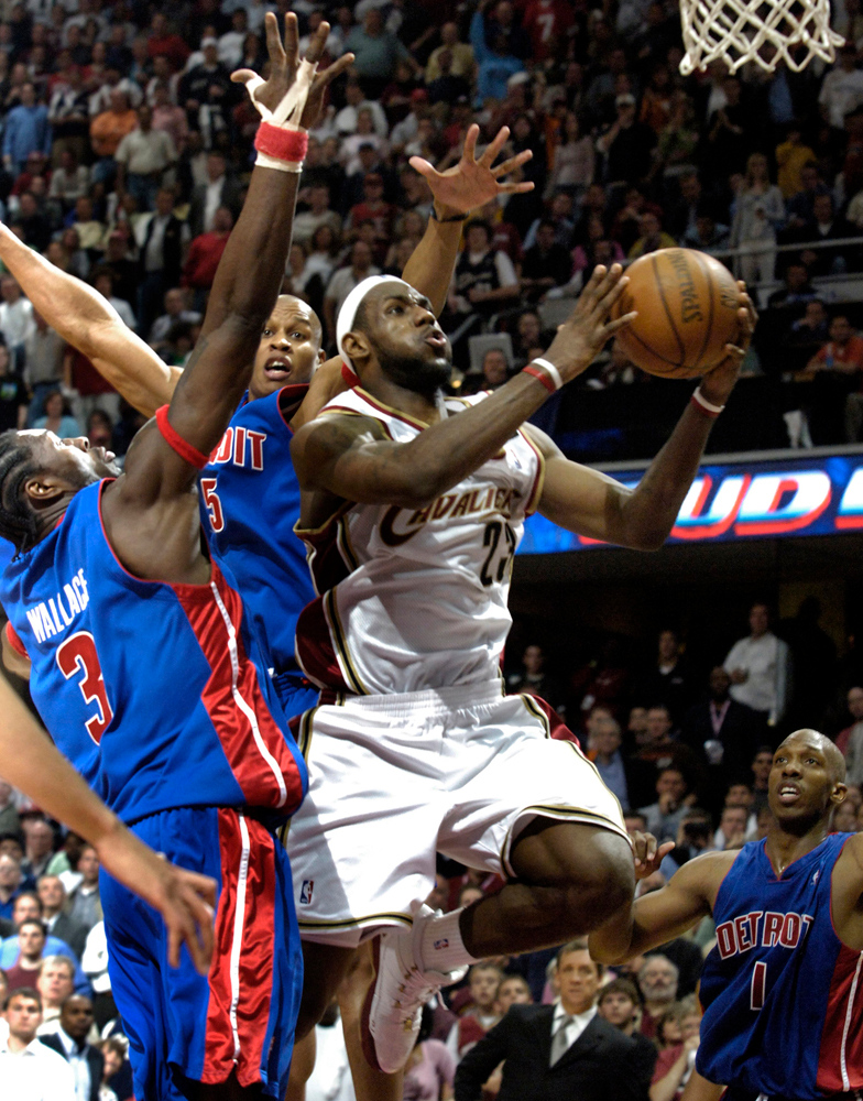 . Michael Blair/MBlair@News-Herald.com The Cavs\' LeBron James splits between Piston defenders Ben Wallace and Maurice Evans for two of his seven second half points.