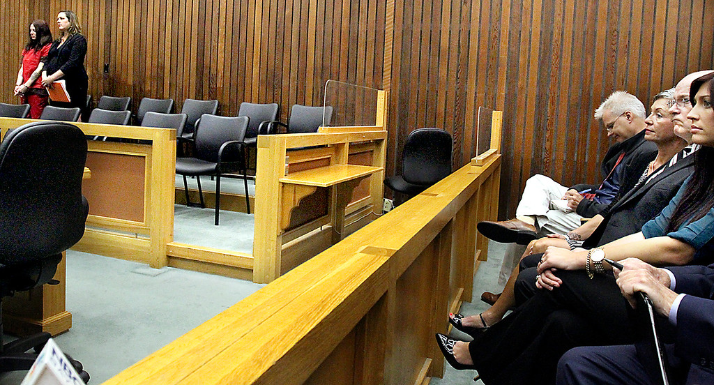 . From far right, Monica, Bart and Leslie Tichelman watch stoically as Monica\'s sister and Bart and Leslie\'s daughter Alix Tichelman stands with her attorney Athena Reis during her arraignment for manslaughter on Wednesday. (Shmuel Thaler -- Santa Cruz Sentinel)