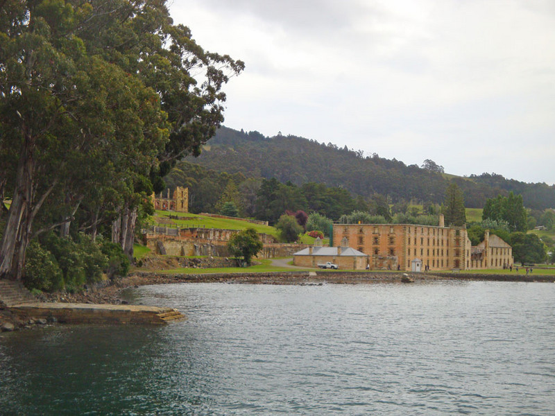 The majority of Australia's convicts were sent to Tasmania, or Van Diemens Land, as it was then known. Those who committed further crimes were sent to harder prisons, among which Port Arthur was most prominent. This notorious penal colony was situated at the end of the Tasman Peninsula, which was separated from mainland Tasmania by a very narrow neck of land, guarded by dogs trained to be vicious. The convicts were also told that the waters were patrolled by sharks. Nevertheless, many tried to escape, and a few succeeded.