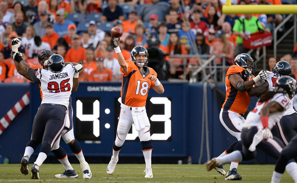 . DENVER, CO - AUGUST 23: Denver Broncos quarterback Peyton Manning (18) throws a pass down field during the first quarter against the Houston Texans August 23, 2014 at Sports Authority Field at Mile High Stadium. (Photo by John Leyba/The Denver Post)