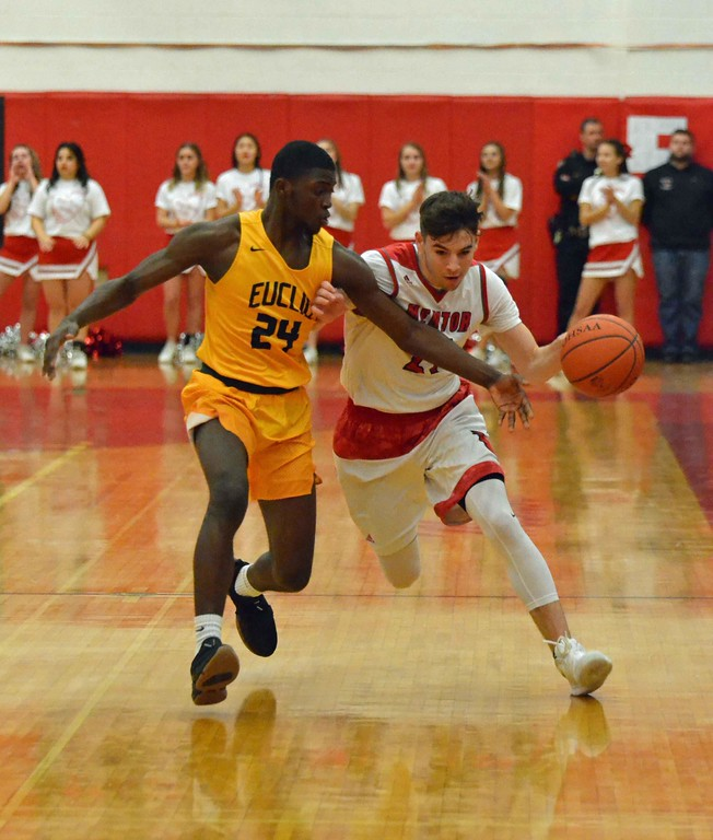 . Paul DiCicco - The News-Herald Action from Euclid-Mentor boys basketball Feb. 13.