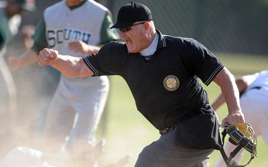 . Home plate umpire makes the call at home plate in the seventh inning of a CIF-SS prep second round playoff baseball game between South (Torrance) and Northview at Northview High School on Tuesday, May 21, 2013 in Covina, Calif. Northview won 5-4.  (Keith Birmingham Pasadena Star-News)