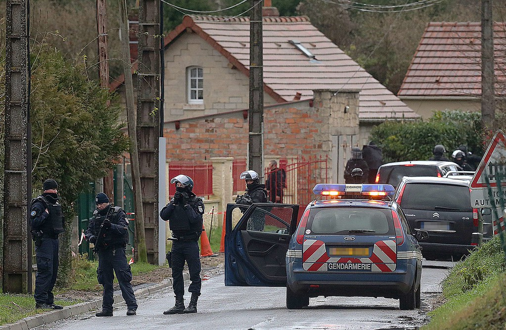 """. Members of GIPN and of RAID, French police special forces, are pictured in Corcy, near Villers-Cotterets, north-east of Paris, on January 8, 2015, where the two armed suspects from the attack on French satirical weekly newspaper Charlie Hebdo were spotted in a gray Clio. French security forces deployed on January 8 in a northern town where two brothers suspected of having gunned down 12 people in an Islamist attack on satirical magazine Charlie Hebdo abandoned their car, a police source said. Cherif Kouachi, 32, a jihadist well-known to police, and his brother Said, 34, were spotted by the manager of a petrol station in the town about an hour\'s drive northeast of Paris, who after being robbed \""""formally identified\"""" the two men. AFP PHOTO / FRANCOIS  NASCIMBENI/AFP/Getty Images"""