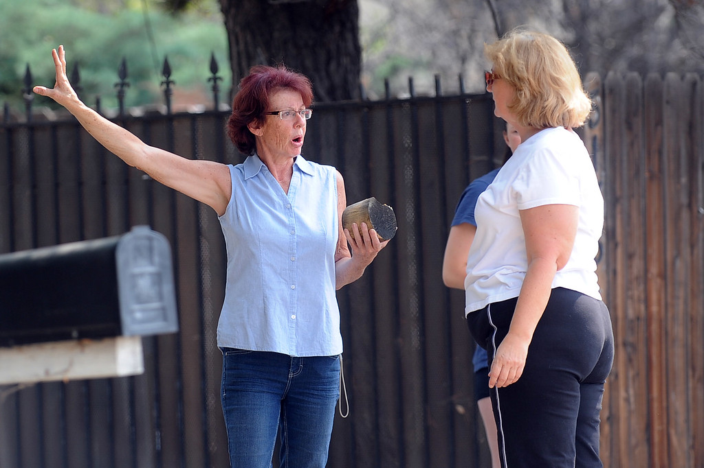 . Homeowner Terri Mongiello holds a piece of debris that broke through a fence in her front yard during a Fourth of July fireworks accident at Rancho Santa Susana Community Park in Simi Valley, CA July 5, 2013.  The accident left 28 people injured. (Andy Holzman/Los Angeles Daily News)