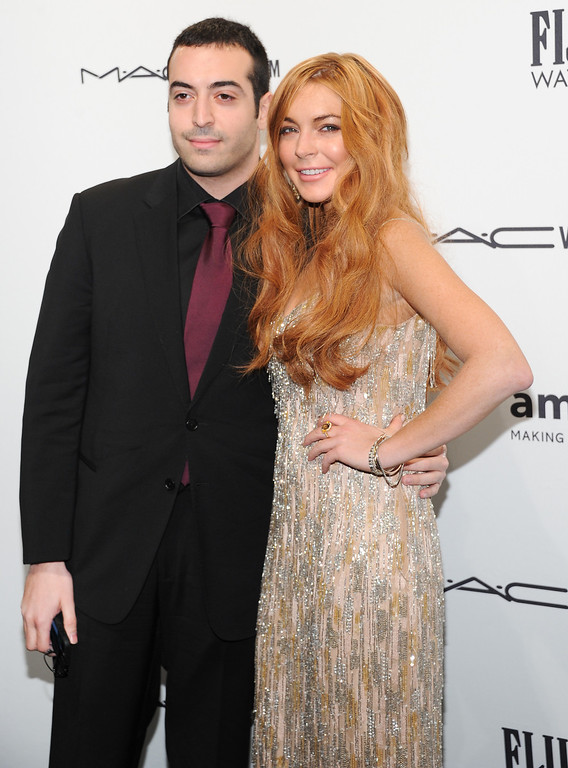 . Producer Mohammed Al Turki and actress Lindsay Lohan attend amfAR\'s New York gala at Cipriani Wall Street on Wednesday, Feb. 6, 2013 in New York. (Photo by Evan Agostini/Invision/AP)