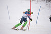 Eva Clough hits a gate in the U16 Slalom race at Bosquet Ski Area on February 2, 2014.