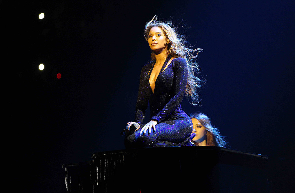 ". IMAGE DISTRIBUTED FOR PARKWOOD ENTERTAINMENT - Singer Beyonce performs on the opening night of her ""Mrs. Carter Show World Tour 2013\"", on Monday, April 15, 2013 at the Kombank Arena in Belgrade, Serbia. Beyonce is wearing a cobalt blue hand beaded jumpsuit by designer Vrettos Vrettakos. (Photo by Yosra El-Essawy/Invision for Parkwood Entertainment/AP Images)"